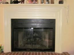 contemporary fireplace glass doors cream wall accessories er