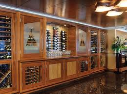 vint single wide wine cabinet with a top mounted cooling system and individual wood wine racks