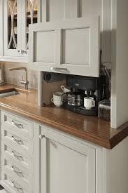 kitchen cabinet garage door steel refrigerator matte black wooden stool steel fridge plain white wallpaint wall mounted black wine shelf