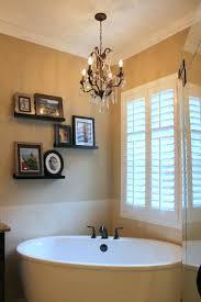 mini chandelier for bathroom. Chandeliers: Mini Chandelier Bathroom Lighting This Beautiful Master Features A Free Standing Kohler Bathtub For I