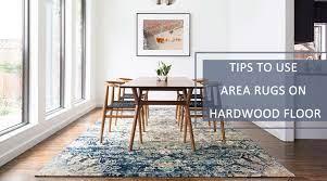 area rugs on hardwood floor