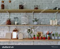 miscellaneous on the wall shelf things on the brick wall shelf shelves on a