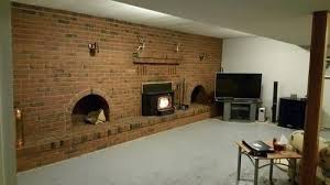 brick wall fireplace looking for some advice on how to update our basement living with this