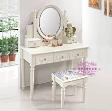 fabulous white makeup table design with drawers and angelic statue