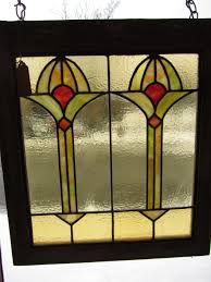 gorgeous antique stain glass window measures 24 1 4 x 22 it is in excellent condition with no s or damage wonderful art deco style design with warm