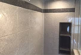 decorative striped border in a diy shower wall panel system in a 12 x 12 tile