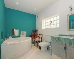 two walls painted turquoise make the bathroom brighter and cooler and create a mood