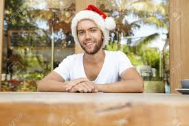 merry and happy holidays to everyone handsome unshaven man in hat with