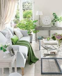 exquisite light grey and neutrals living room with sage green accents and potted plants