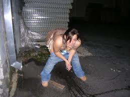 Drunk girl pissing outdoors