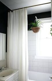 shower curtain height i really like this shower curtain hung at ceiling height instead of lower