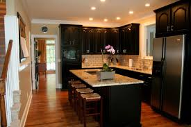 black kitchen cabinet design with brown floor and lighting cabinet and lighting