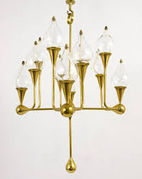 a very beautiful brass chandelier candle holder with 12 arms 12 glass oil candles