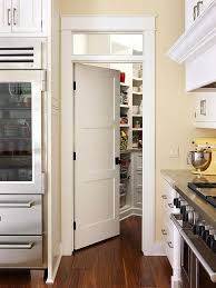 Conceal a pantry and trick guests into thinking your kitchen is larger by  using interior doors for the pantry. This chic look creates an illusion of  space ...