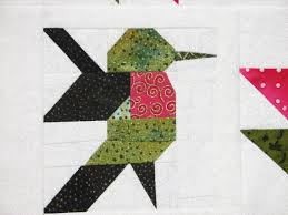 Hummingbird @ a fuchsia block"