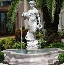 white marble lady statue flouring water