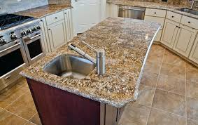 granite island with natural stone tiles