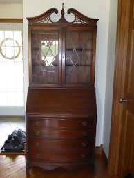 antique secretary desk looking for information regarding the age and make