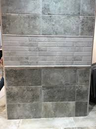 an example of brick like subway tiles juxtaposed with large format tile in a concrete