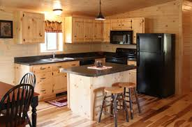 Unstained Wooden Kitchen Cabinet Using Black Countertop Gray Wash