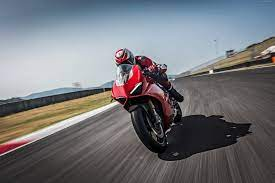 Person riding sports bike on road HD ...