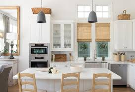 white kitchen island with tan ladder back counter stools