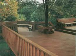 deck ideas. This Deck Features A Tree Surround To Accommodate Growing Trunk Yet  Provides Plenty Of Floor Ideas