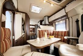 Luxury By Design Rv Seating Area And Table In Concorde Luxury Motorhome Interior Stock