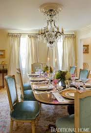 a beautiful antique french chandelier illuminates the room creamy dedar dries add intimacy to the space