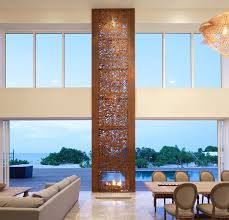 13 examples of how to incorporate a double sided fireplace into your home