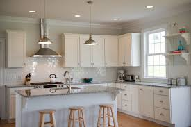 elegant l shaped kitchen photo in dc metro with granite countertops shaker cabinets