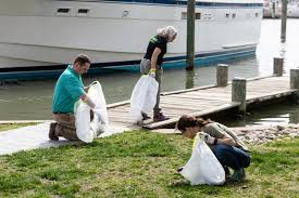 hilton garden inn annapolis downtown volunteers jeremy and mary join staff from the alliance for the chesapeake bay to pick up litter as part of project