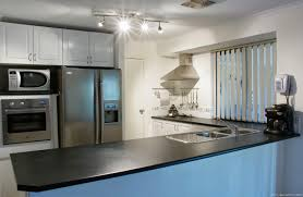 Home Hardware Kitchen Appliances Beige Ceramic Tile Floor Shiny Black Granite Countertop Kitchens