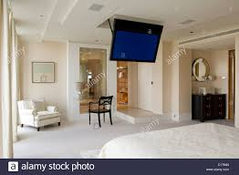 bedroom with tv. Flat Screen Plasma TV Mounted To The Ceiling In Modern Bedroom With Tv C