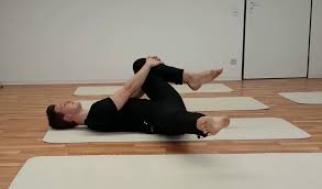 inflexible splits. hold it there - pulling towards a split position. inflexible splits
