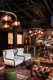 Restaurant design  Q & C Hotel and Bar - The lobby blends concrete floors  and exposed ductwork with
