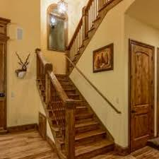 Rustic Stairway With Arched Mirror