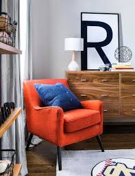 orange chair with mid century modern dresser