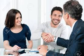 Happy Couple Seal A Deal With Their Personal Financial Advisor