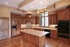 oak kitchen cabinets with granite countertops. The Beautiful Honey Oak Cabinets In This Contemporary Kitchen Contrast With Glossy Black Appliances. Granite Countertops M