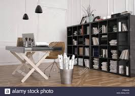 work tables office. Work Table Or Design Workbench In An Office Interior With A Large Bookshelf On The Wall Filled Binders, Magazines And Books Tables