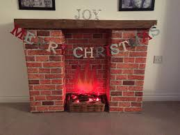 homemade fireplace cardboard bo covered in brick wallpaper and wood effect vinyl fake fireplacedecorative fireplacediy
