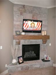 fireplace makeover using mantels with corbels and stone style surround