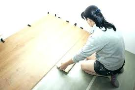 how to remove vinyl flooring from plywood removing beautiful woman puts laminate take off floor tiles how to remove vinyl