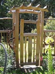 Small Picture Classic Garden Arbor With Gate In Impressive Garden Arbor With