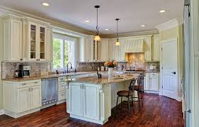 antique white cabinets diy. country style white kitchen cabinets with antique brown granite and dark parquet flooring hanged lighting fixtures diy p