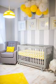 Yellow & grey nursery with handing pom pom decorations
