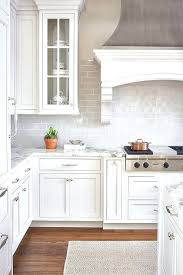 best 25 glass subway tile backsplash ideas on subway 53 best white kitchen designs kitchen backsplash white cabinets black countertop