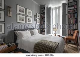 ... Calm Grey Tones And Book Shelving In Bedroom With 1940s Murano Glass  Wall Lights   Stock