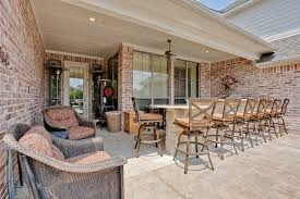 outdoor kitchen bar designs. example of a mountain style patio kitchen design in dallas outdoor bar designs